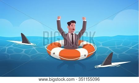 Businessman Raising Hands Inside Lifebuoy In Water Full Of Shark Helping Business To Survive Help Su