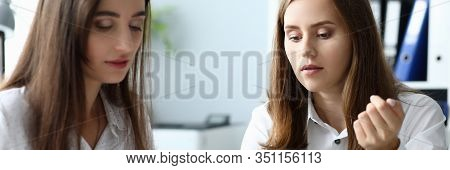 Portrait Of Joyful Businesswoman Concentrated On Important Documents And Discussing Profitable Tacti