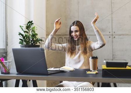 Manager At Office Desk Happy To Learn Good News. Project Successfully Accomplished. Girl Watching Fu