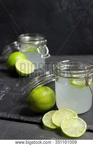 Lime Juice In Glasses On Dark Stone