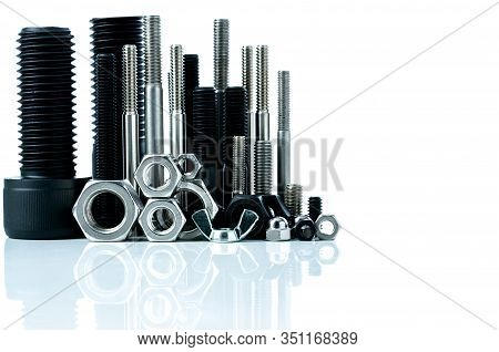 Metal Bolts And Nuts On White Background. Fasteners Equipment. Hardware Tools. Stud Bolt, Hex Nuts,