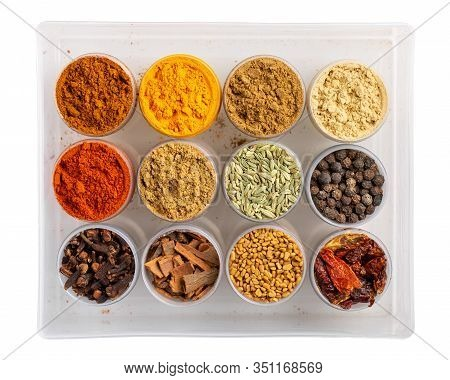 Colorful  Spices In Plastic Containers Isolated On White. Indian Spice Set. Top View.