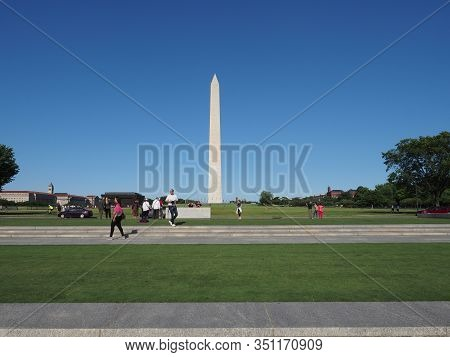 Washington D.c., Usa - June 3, 2019: Image With The Many Tourists Near The Washington Monument.
