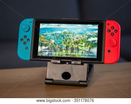 Uk - Feb 2020:nintendo Switch Games Console With Fortnite Game Playing On Screen