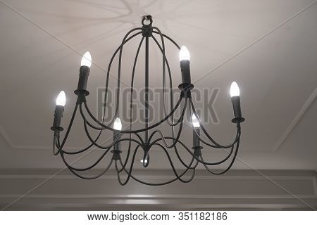Classic Chandelier On The Ceiling. Lighted Lamp Shade. Ray Of Light. Closeup Lamp Decorated Interior