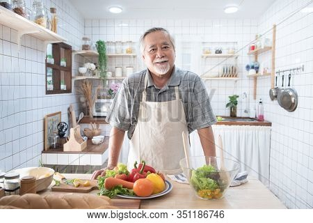 Portrait Of Happy Senior Elderly Asian Grandfather Standing Cooking Meal In Kitchen,old Men Prepare
