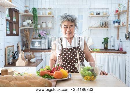 Portrait Of Happy Senior Elderly Asian Grandmother Standing Cooking Meal In Kitchen,old Women Prepar
