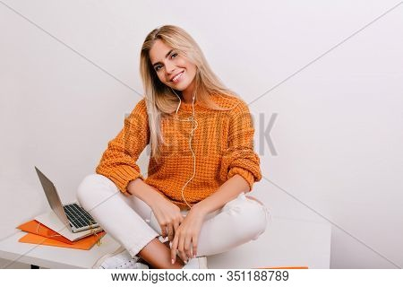 Indoor Portrait Of Smiling Pretty Girl With Elegant Manicure Listening Music During Break At Workpla