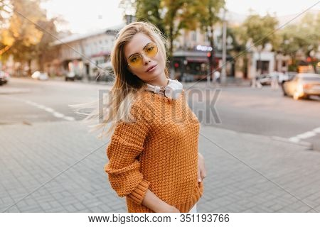 Little Bit Tired Woman In Vintage Knitted Sweater Walking Down The Street. Wonderful Blonde Young La