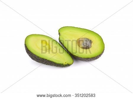 Half Cut Ripe Avocado With Seed And Shell On White Background