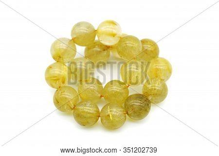 Rutile In Quartz Gemstone On White Background. Rutile Quartz Stone Beads.