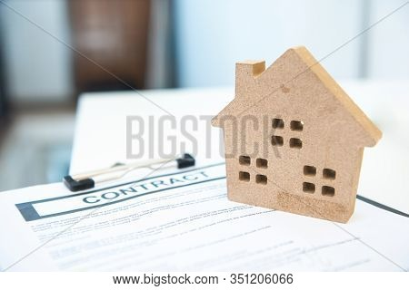 Contract Sign With House Toy Shape,concept Of Real Estate And House Property.