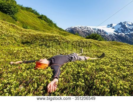 Relaxing backpacker in the mountains.