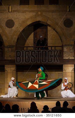 Green Sufi Dancer Spinning Traditional Dance