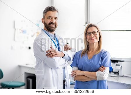 A Dentist With Dental Assistant In Modern Dental Surgery.