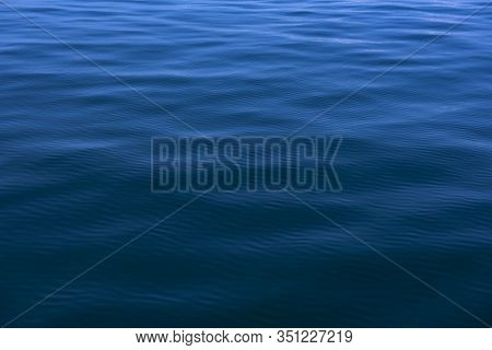 Blue Water Background With Ripples Sea Low Angle View, Ocean, Wave.   Travel Destination And Nature