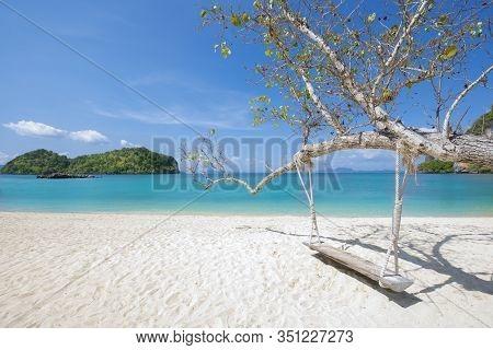 Wooden Swing Hang Under Tree At Koh Phak Bia Island, Krabi, Thailand. Travel Destination And Nature