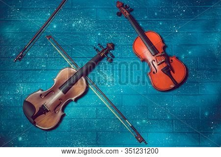 Classical Music Concert Poster With Orange Color Violin On Blue Background With Copy Space For Your