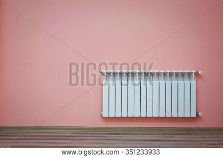 Home Gas Heater Closeup .heating Radiator On A Pink Wall At An Apartment. Modern Living Room. Radiat