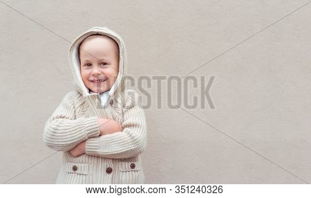 Little Boy 4-5 Years Old, Stands Beige Wall, Emotions Of Happiness, Joy, Fun And Smile. European Bab
