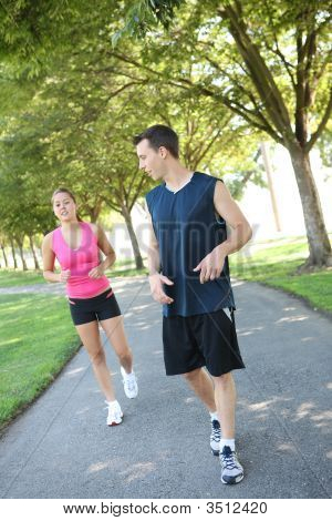 Attractive Man And Woman Couple Jogging