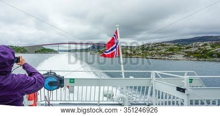 A Ferry Traveler Photographs A Bridge In The Narrow Spot Of The Sogne Fjord, The Longest Fjord In Th