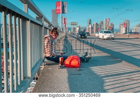 Vancouver - May 05 2019: Downtown Vancouver Canada. Scenic View At Grandville Bridge Ayoung Woman Is