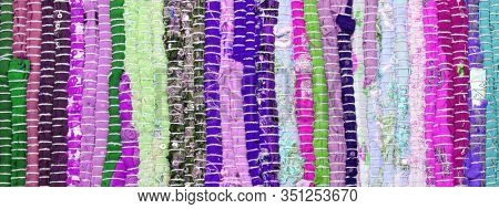 Rustic rug made of fabric flap. Abstract color horizontal background.