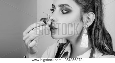 Girl Fashionable Makeup Face And Cute Snail. Cosmetology Beauty Procedure. Skin Care. Massage With S