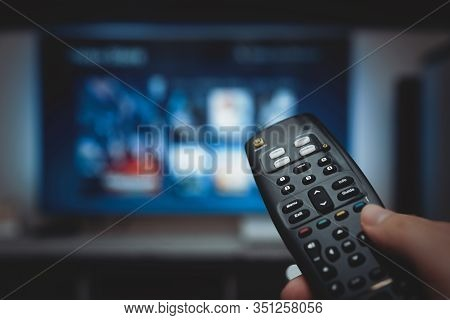 Vod Service On Television. Man Watching Tv, Streaming Service, Video On Demand, Remote Control In Ha
