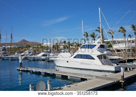 Puerto Calero, Lanzarote, Spain - December 29, 2019: Marina Of Puerto Calero On A Sunny Day In Lanza