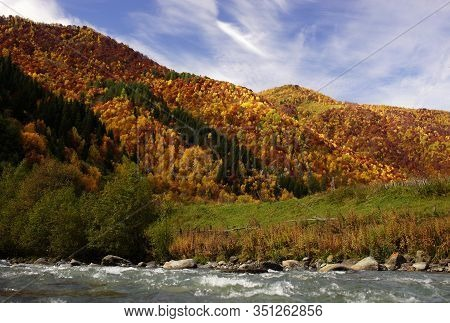 Incredible View Of Georgian Hills With Colorful Autumn Leaves Of Trees And Blue River On Background