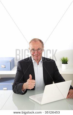 Senior Businessman Giving Thumbs Up Gesture
