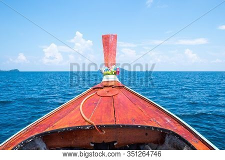 Front Longtail Boat And Blue Sea And Sky