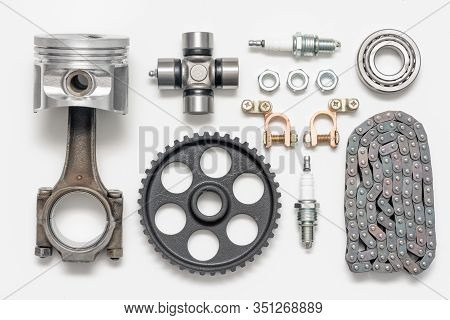 Car Spare Parts On Gray Background Top View.