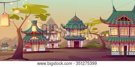 Chinese Village Street With Old Traditional Typical Houses And Garland With Lanterns Hang On Green T
