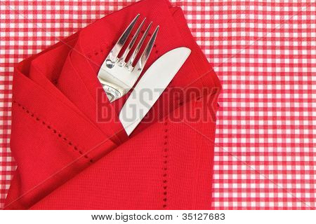 Knife And Fork With Check Tablecloth