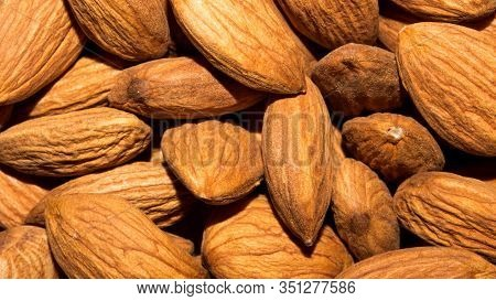 Nuts Almonds.background Of Peeled Almonds.the Texture Of The Almonds.