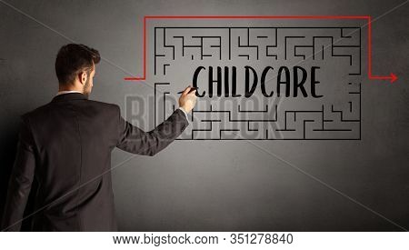businessman drawing maze with CHILDCARE inscription, business education concept