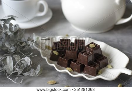 Homemade Chocolates With A Teapot And A Cup Of Coffee