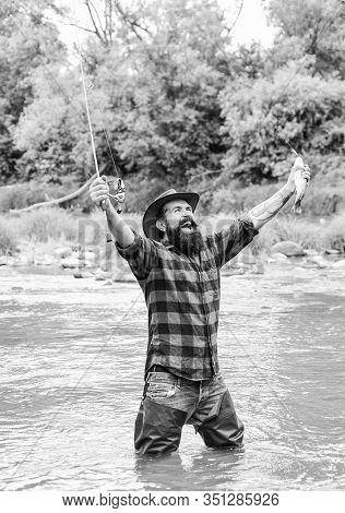 Satisfied Fisher. Fisher Masculine Hobby. Fishing Requires You To Be Mindful And Fully Present In Mo