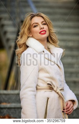 Girl In Warm Coat Stand Urban Background. Create Fall Outfit To Feel Comfortable And Pretty. Autumn