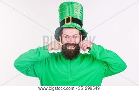 Happy Saint Patricks Day. Hipster In Leprechaun Hat And Costume Twirling Moustache. Getting The Best