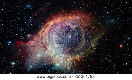 The Helix Nebula Is A Large Planetary Nebula Located In The Constellation Aquarius. Elements Of This