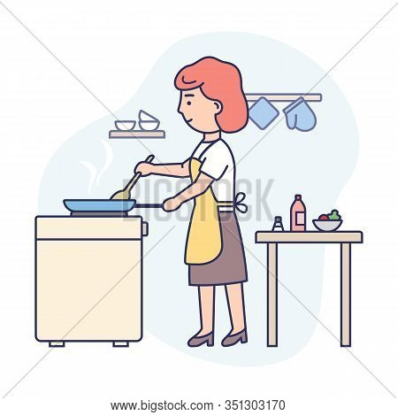 Cooking Concept. Kitchen Interior. Happy Woman Is Cooking Food At The Kitchen. Woman Is Frying Food