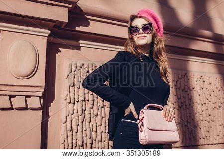 Female Beauty, Fashion. Stylish Woman Wearing Pink Beret, Glasses Holding Purse Outdoors. Spring Clo