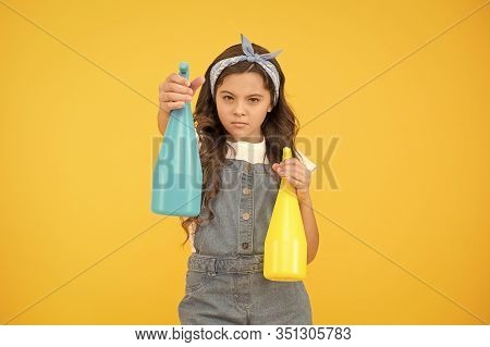 Do You Want Your House To Be Neat And Tidy. Small Child Keep House Clean. Little Girl Use Spray Bott
