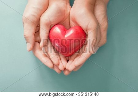 Adult And Child Hands Holding Red Heart , Heart Health, Donation, Happy Volunteer Charity, Csr Socia