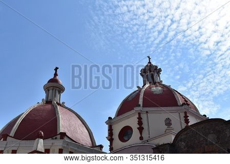 Dome Of The Parish Church Dedicated To The Patron Of The City Where Clear Sky And Extended Clouds Ar