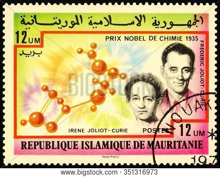 Moscow, Russia - February 18, 2020: Stamp Printed In Mauritania, Shows Frederic And Irene Joliot-cur
